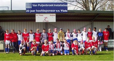Halas Hawks FC U14 team photo with opposition in Holland