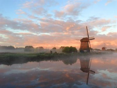 Fog Shrouded Windmill In Holland